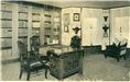 Image of library at Glen Iris Mansion, Letchworth State Park, with tall shelves of books and a desk